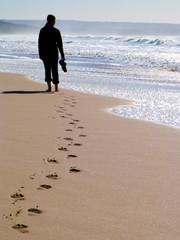 Woman walking alone at the beach