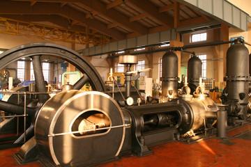 Vintage steam powered water pumping machine.