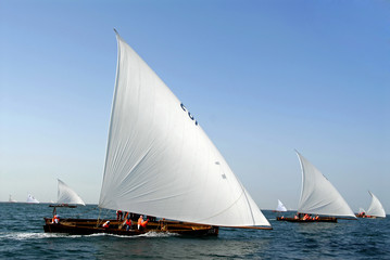 Arabic Wooden Sailing Dhows Spread Throughout The Ocean
