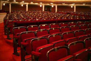 Classical theatre interior with red seat and number