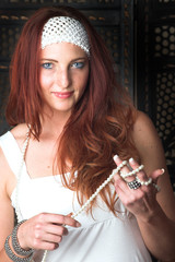 Young female adult fashion model with natural red hair