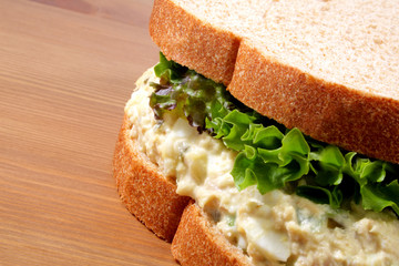 Tuna fish salad sandwich on wheat bread with lettuce