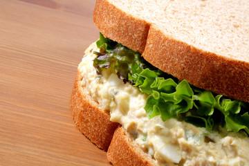 Tuna fish salad sandwich on wheat bread with lettuce