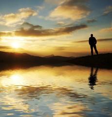 Man silhouette on sunset