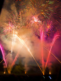 Fireworks display with multiple bright bursts poster