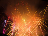 Fireworks display wityh multiple bright bursts poster