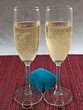Two flutes of Champagne and two Wedding Bands