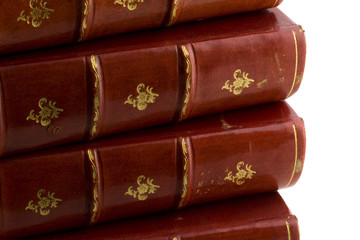 stack of old books in red leather