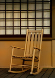 Chair on the front porch in a small southern town poster