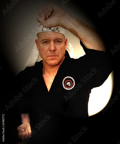 Image of Fourth Degree Blackbelt man in Pose