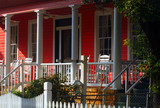 Nice image of a beautiful Southern front porch with a rocker poster