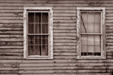 Image of weathered southern home with two windows poster