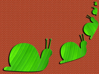 escargots sur mur de briques