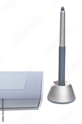 A graphic tablet detail with pen isolated on white background