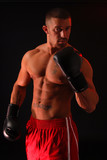 A muscular boxer in the spotlight poster