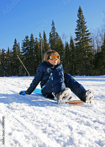 relaxing girl with snowboard over the mountain background