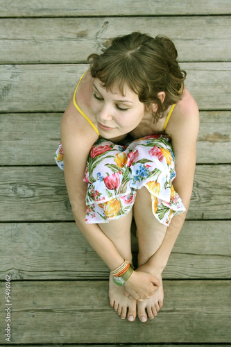 the summer girl  over the wooden background