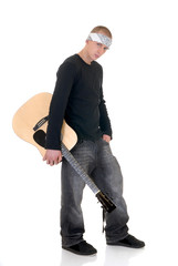 Handsome youngster, male teenager with guitar,