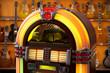 Leinwanddruck Bild - jukebox in front of guitars - selective focus on jukebox