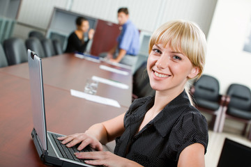 Confident smiling specialist looking at camera in the boardroom
