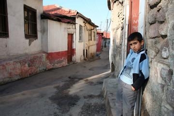 a child is standing in front of his house