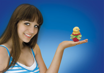 pretty girl with chick in a easter egg