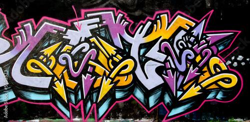 grafitti tag yellow and purple - 5505323