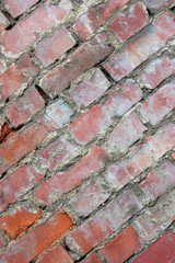 diagonal perspective of old decaying brick wall