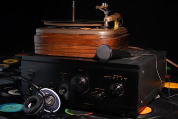 sound equipment on top of vinyl records
