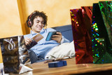 guy relaxing on the couch after shopping poster