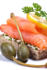 Smoked salmon sandwich with capers and lemon