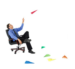 Businessman launching colored paper planes - isolated
