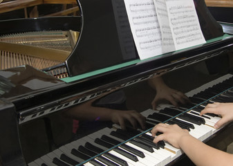 Fragment of hands of the musician playing the pianoclassics
