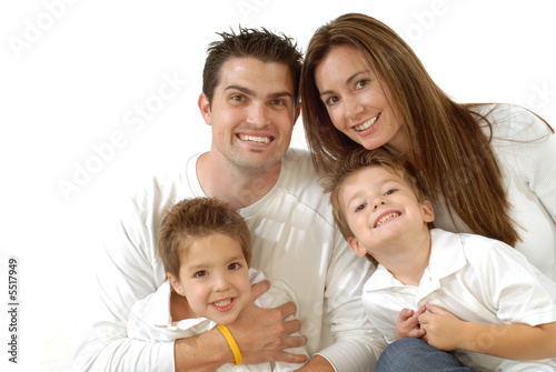Attractive young family laughing while posing together