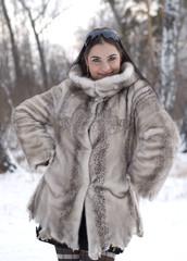 posing girl in a fur coat