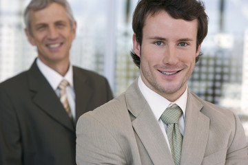Confident young businessman with colleague