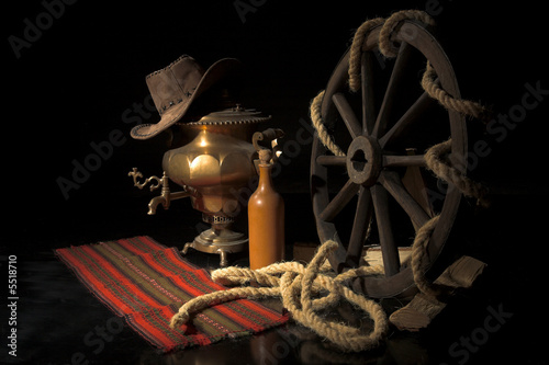 village still life with wood wheel and rope