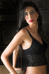 Beautiful young sexy adult Italian woman with long black hair