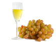 Glass of white wine and grapes isolated on white