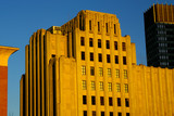 the warm glow of sunset on old art deco building in boaton poster