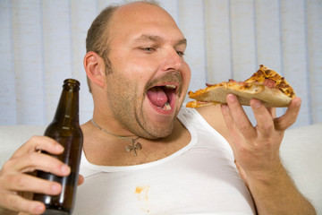 Overweight mature man with pizza