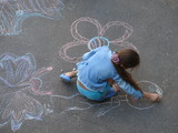 female child drawing picture with chalk poster