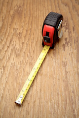 Tape measure on wooden panel