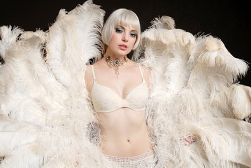 Beautiful Woman holding feathers in lingerie