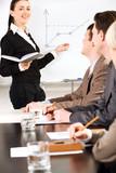 Businesswoman speaking her presentation on whiteboard