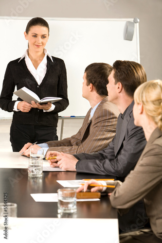 Image of woman suggesting a new project to business people