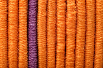 One lilac and many orange elastics