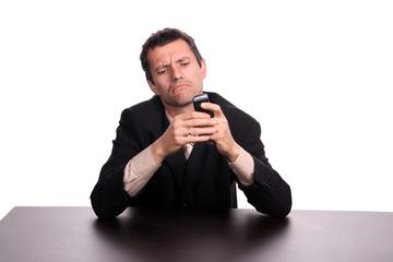 businessman on the phone sending message