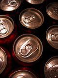 Macro shot of the tops of a bunch of aluminum cans. poster