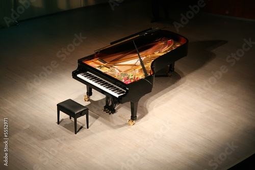 Leinwanddruck Bild piano with  bouquet of flowers on scene in  concert hall